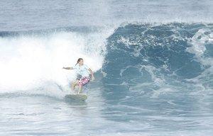 1497fc40a5-Surfing_Uluwatu_Bali